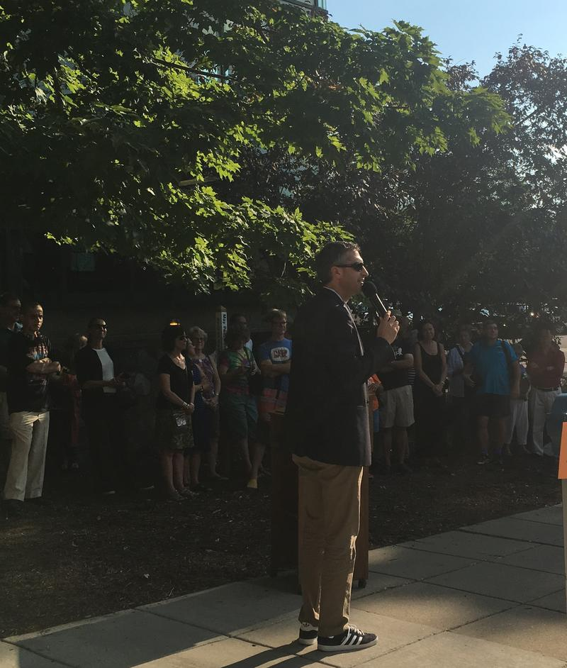 Ann Arbor mayor Christopher Taylor addresses the crowd gathered before the unveiling