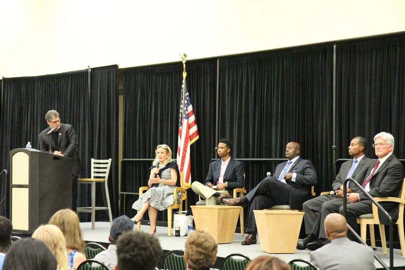 July 21st WEMU Town Hall Forum on Policing and Community Interactions. 89.1 WEMU's David Fair at the podium. Panelists, left to right: 12th District Congresswoman Debbie Dingell. Black Lives Matter organizer, Myles McGuire, Washtenaw County Sheriff Jerry