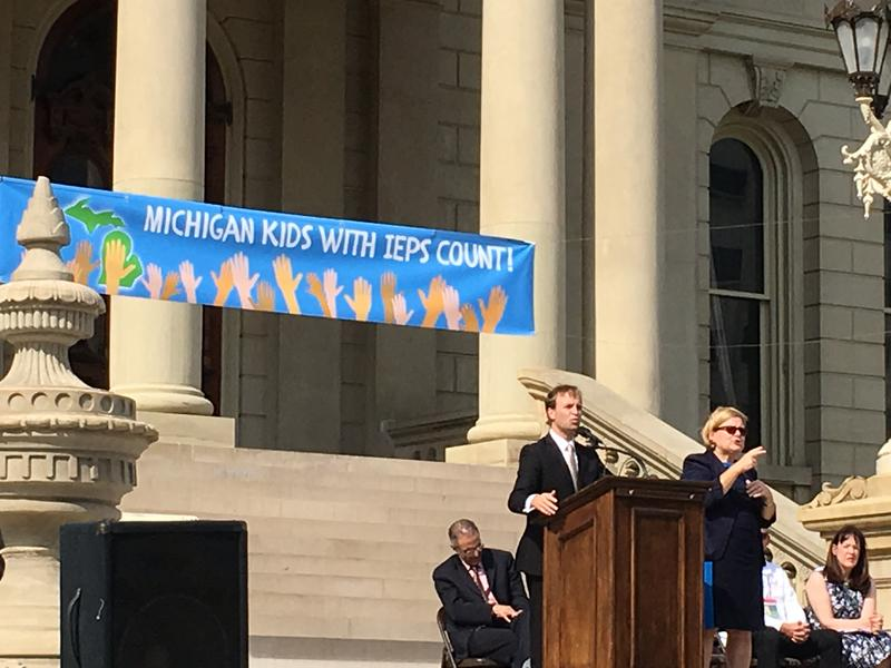 Lt. Gov. Brian Calley speaks on the Capitol steps about special education reforms at the rally.