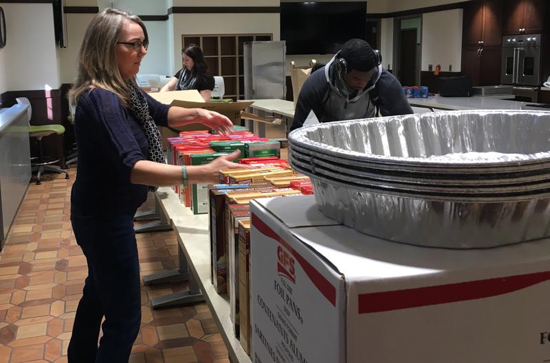 A student prepares food at the Swoop Food Pantry.