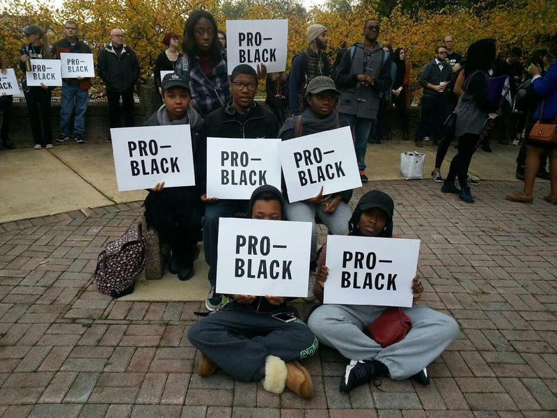 EMU students hold Pro-Black signs.