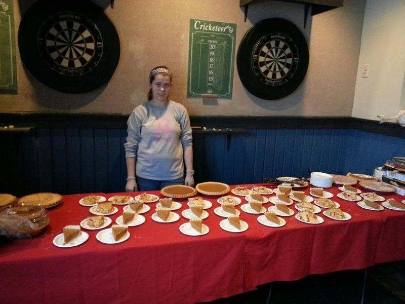 A volunteer gets ready to serve pie.