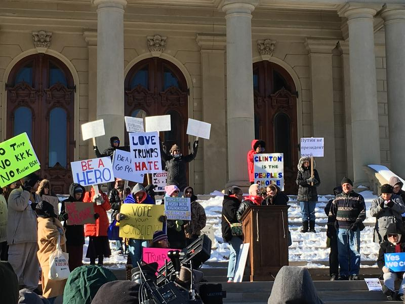 Protestors gathered on the steps of the state Capitol to urge the Electoral College to not vote for president-elect Donald Trump.