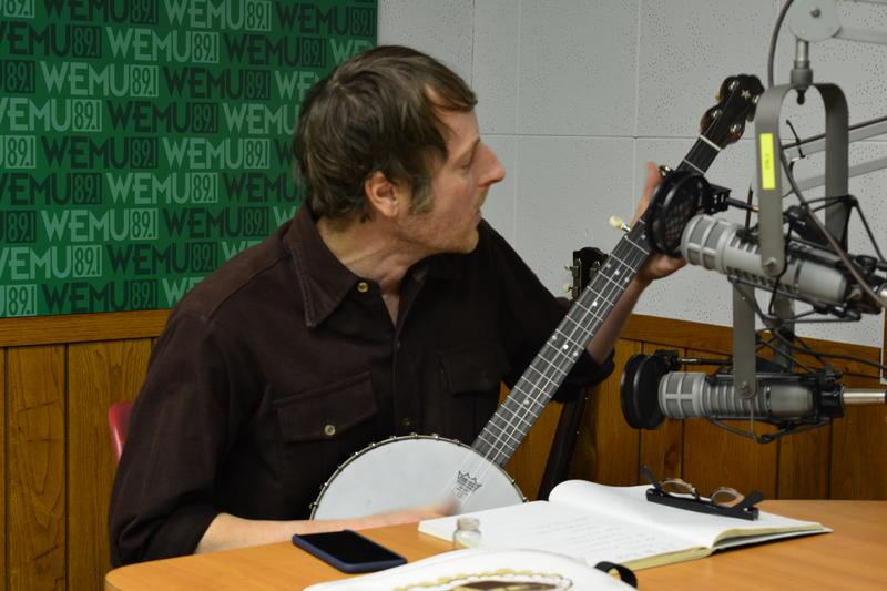 Danny Kroha plays his banjo.