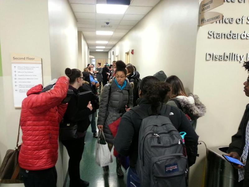 Nearly 50 people wait outside the Office of Student Conduct on campus during the hearing.