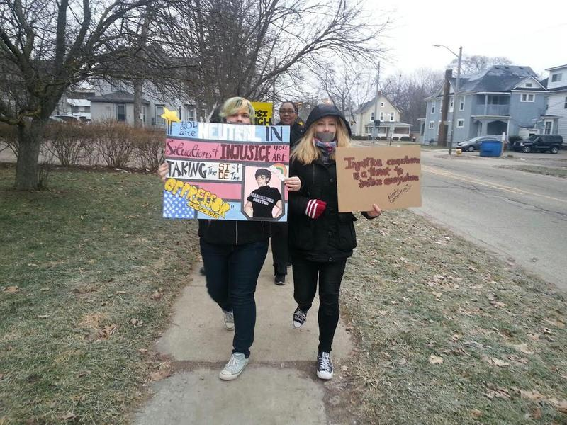 Students march with duct tape on their mouths.