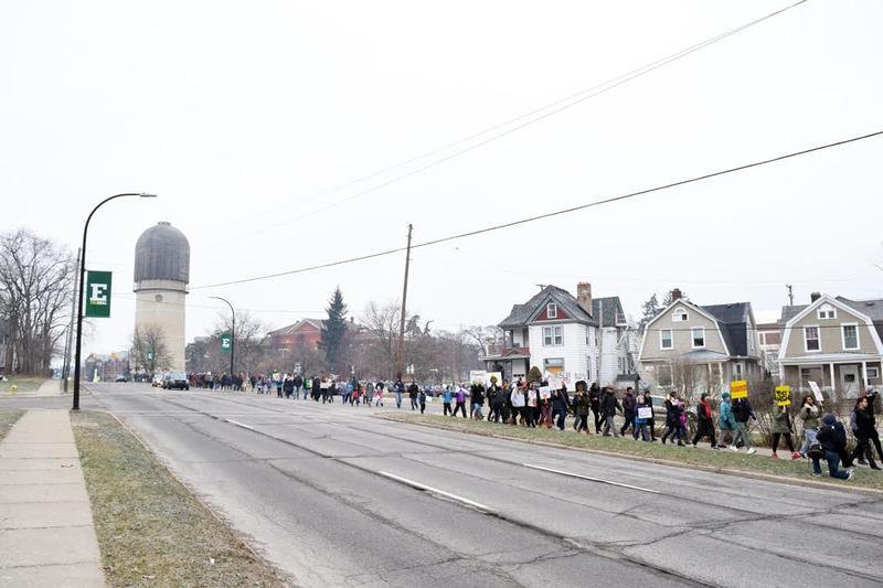 Participants march down Washtenaw Avenue.