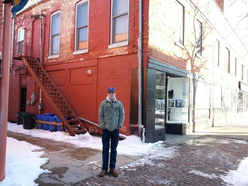 Historian Matt Siegfried stands outside the Mix Space building that once housed Hewitt Hall in Ypsilanti.