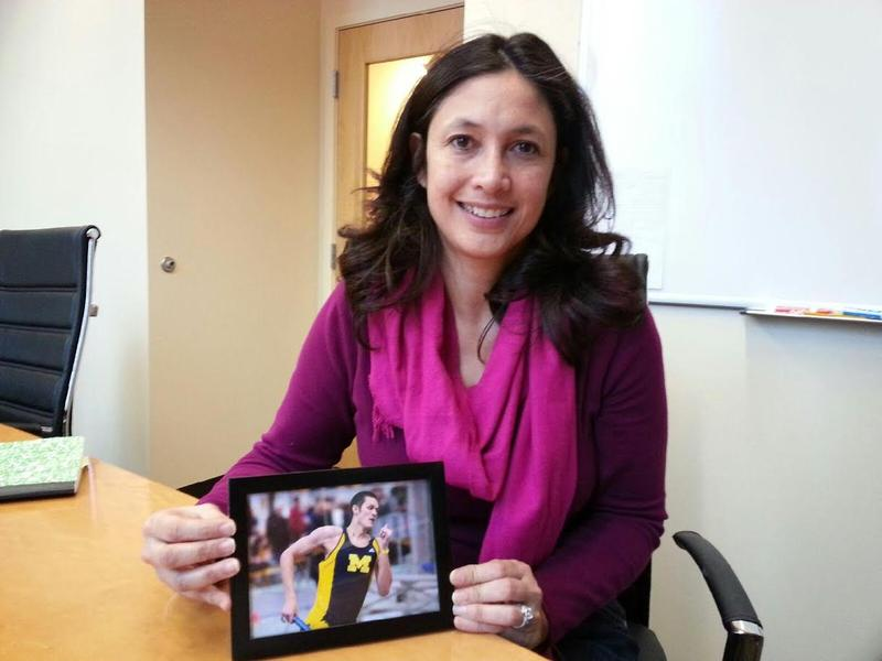 Cathy Radovich holds-up a photo of her son Garrick.