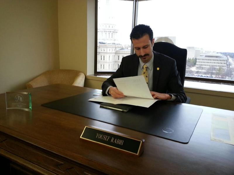 53rd District State Representative Yousef Rabhi at his desk in Lansing.