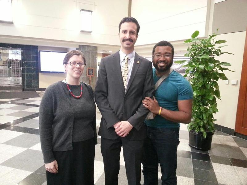 Rabhi with his staff in Lansing.