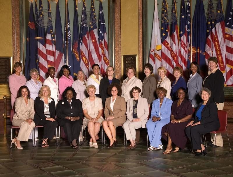 Alma, sitting down on the far right, with the Michigan Legislative Womens Caucus in 2008.