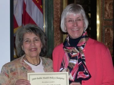 Alma receiving a Public Health Policy Champion Award.