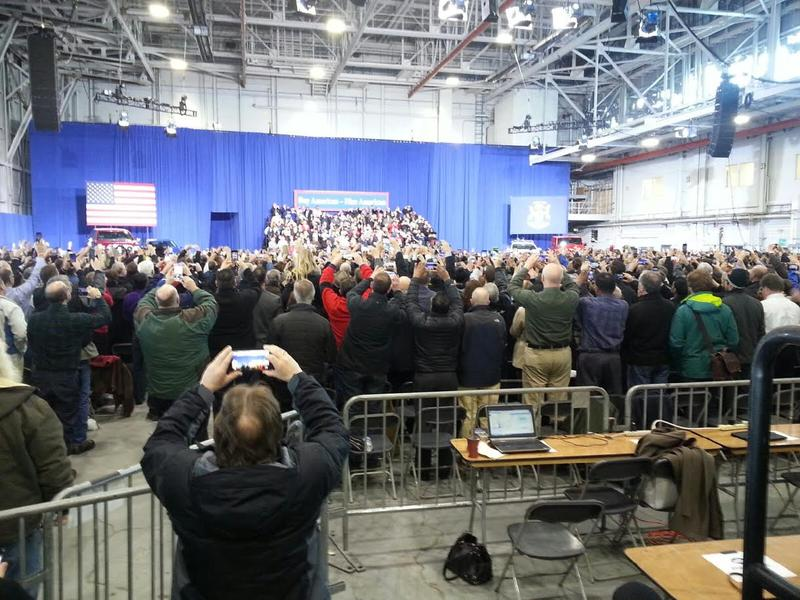 Those who attended the event took photos as the president arrived at the American Center for Mobility.