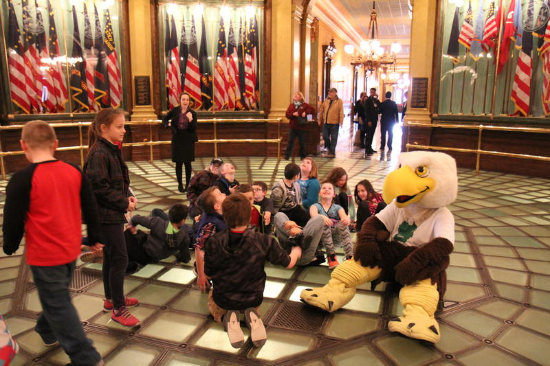 Swoop sits with kids at the state Capitol.