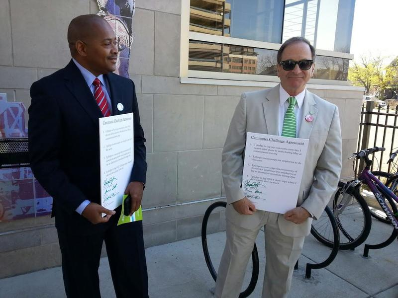 Washtenaw County administrator Greg Dill (L) and Ann Arbor city administrator Howard Lazarus (R) sign a pledge to participate in the challenge.