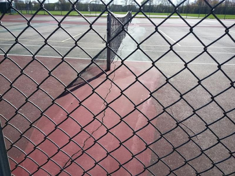 Cracks on the tennis courts at Scarlett Middle School.