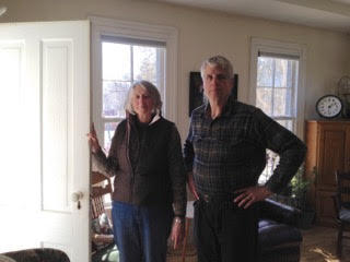 "Mary Goode and Woody Vellum showing the ""funeral door"" of their pre-Civil War era home"