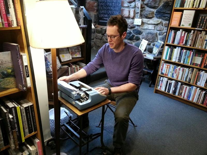 Michael Gustafson types a message about Ann Arbor at Literati Bookstore.