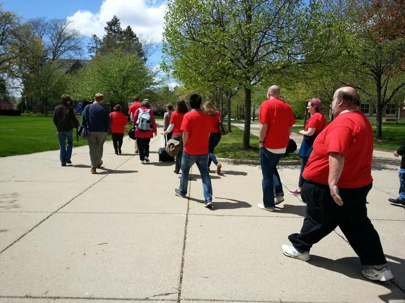 Members of EMU's Federation of Teachers and their supporters rally on campus on May Day.