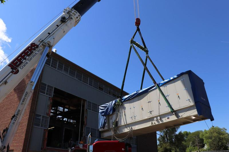 Turbine being moved into heating plant at EMU.