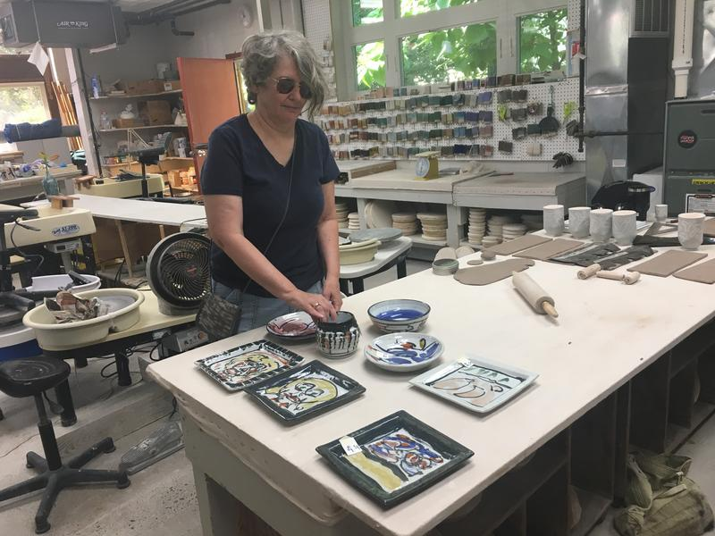 Teri Adams-Abernathy working in the pottery studio.