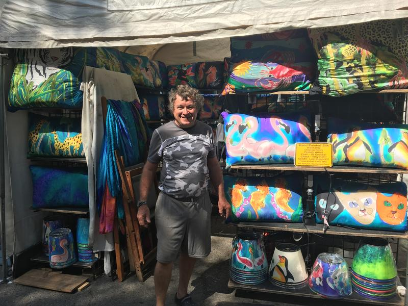 French artist Philippe Laine in front of his booth On Main Street near Liberty