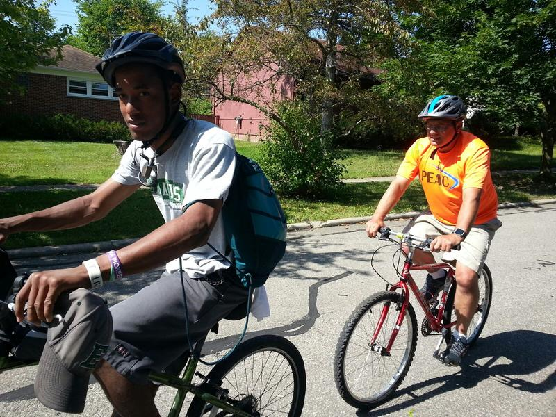 PEAC student James Kleimola on left rides with Executive Director John Waterman in Ypsilanti.