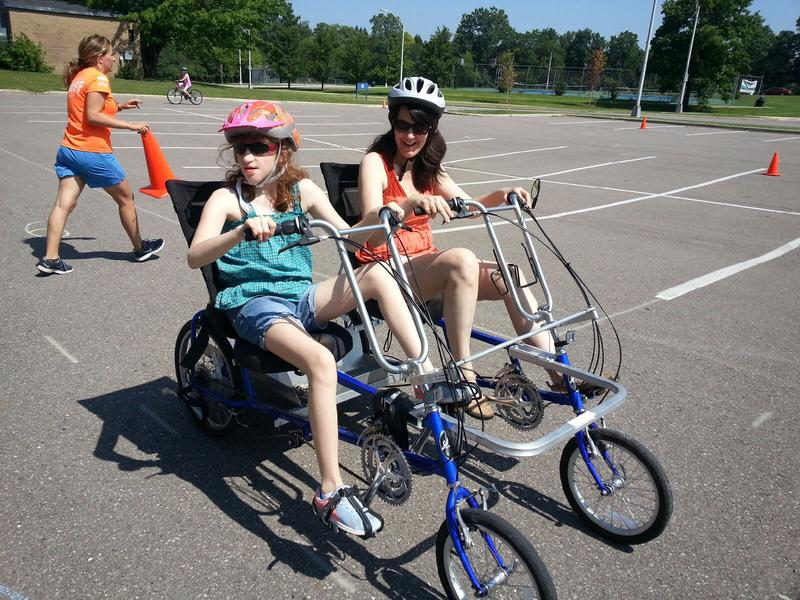Thirteen year old Ellie rides with her mother Margo Tish on a side-by-side bike.