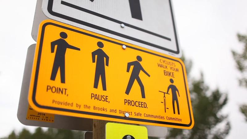Crosswalk sign from Alberta, Canada.