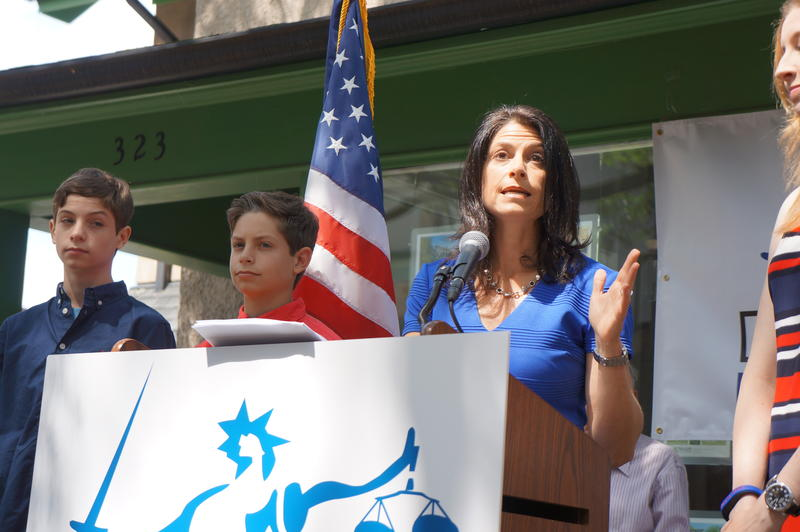 Dana Nessel stands with her two sons and wife to announce her candidacy for state Attorney General.