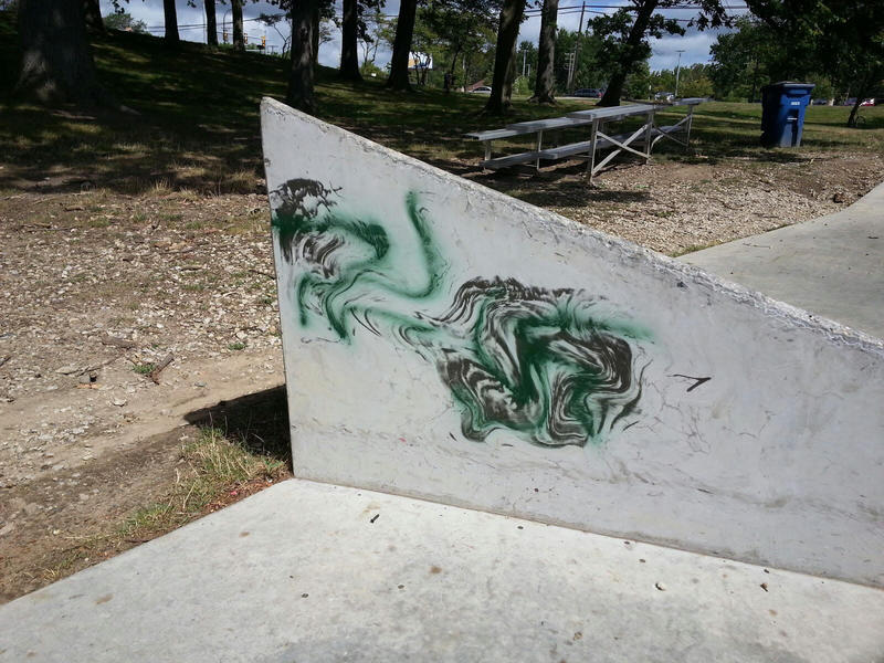 Swastikas and racial slurs were spray painted at the Veterans Memorial Skate Park in Ann Arbor.  Image blurred on purpose.