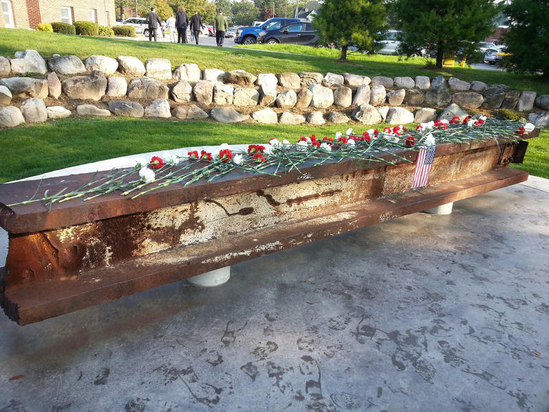 Carnations decorate the steel beam that came from the 74 floor of the South Tower of the World Trade Center.