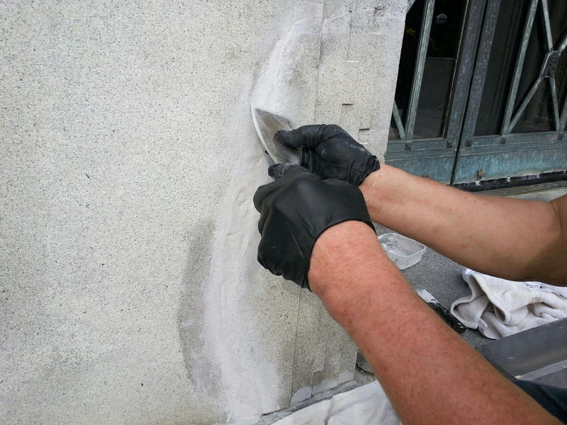Ron is filling in the cracks and smoothing out the stone.
