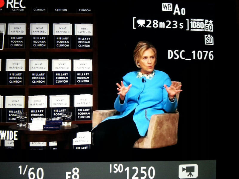 Hillary Clinton through camera screen lens.