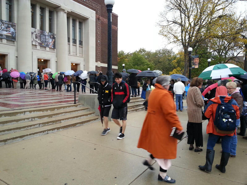 Clinton Supporters wait in line outside of Hill Auditorium .