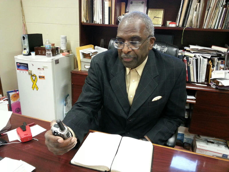 Pastor Jerry Hatter holds one of the Walkie-Talkie's the church is now using to improve communication between staff.