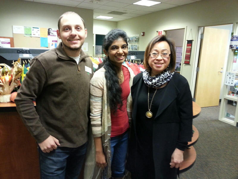 On the right, Esther Gunel, Director of the Office for International Students and Scholars at EMU.  She's joined by students Kareem Aljundi from Syria and Geetica Inampudi from India.