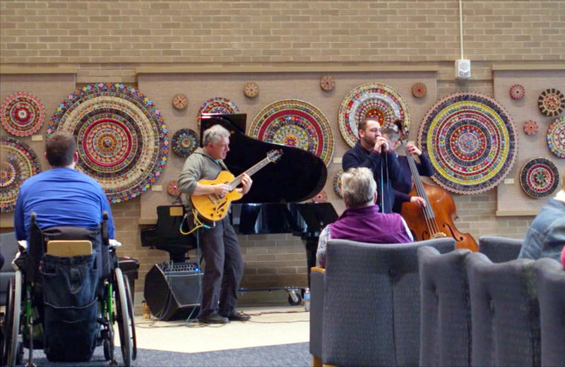 Singer Brad McNett entertains as part of the Gifts of Art program at Michigan Medicine