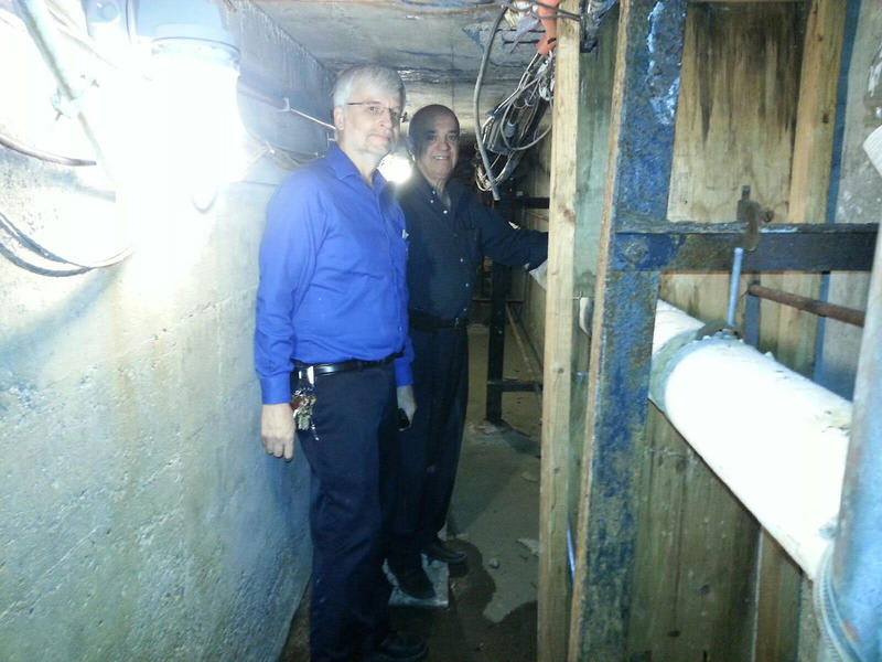 Mark Monarch on left and Bilal Sarsour on the right in the Ford Hall tunnel.  Both work for EMU's Physical Plant.