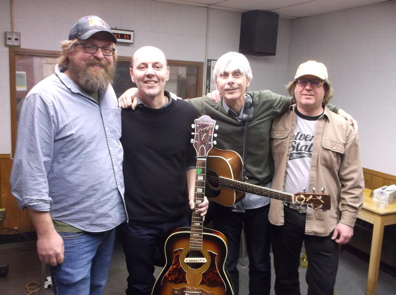Roots Music Project host Jeremy Baldwin with (From L to R) Jud Branam, Kevin Brown, and Jerry Hancock of Corndaddy.