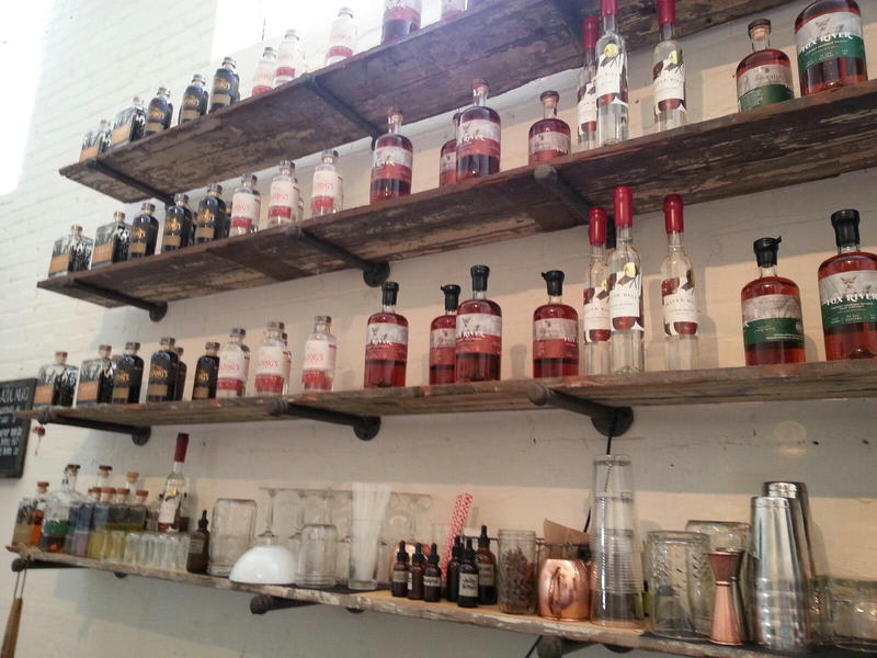 Shelves in the tasting room display spirits made at the distillery.