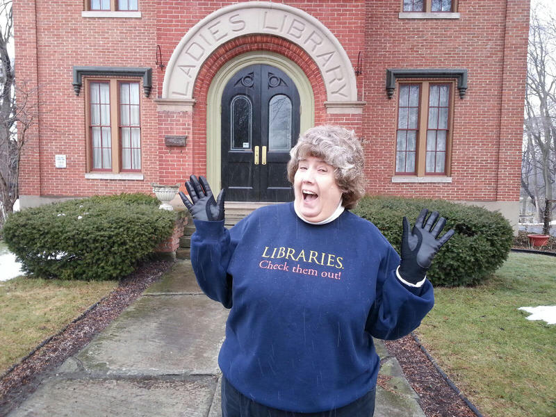Donna DeButts outside the Ladies Library building in Ypsilanti.