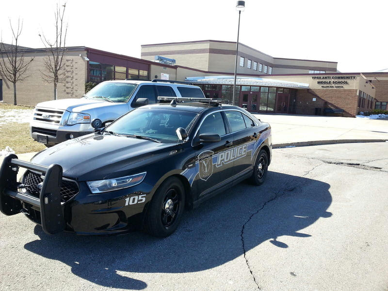 Police car parked outside of Ypsilanti Community Middle School.