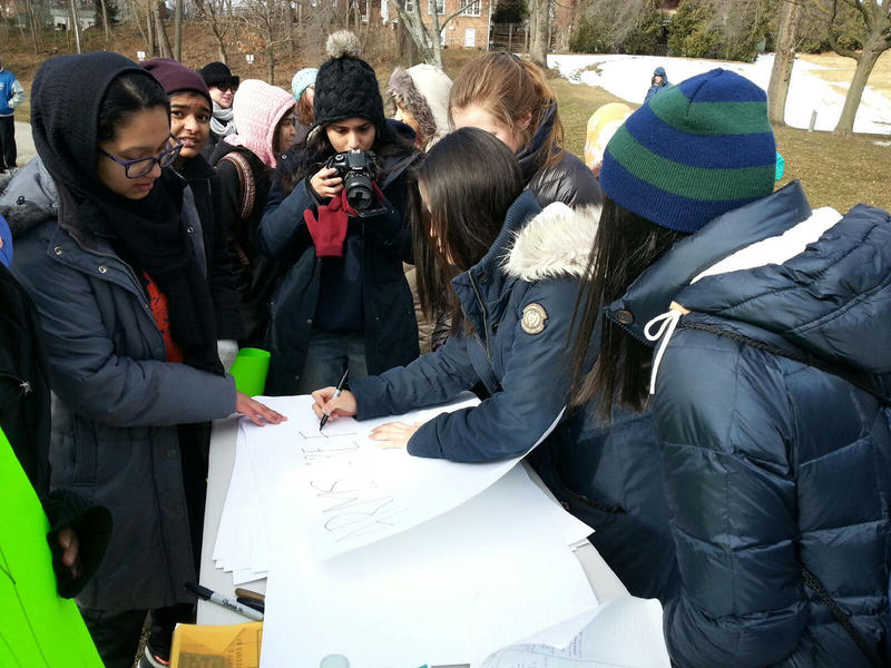 Students at the rally making posters.