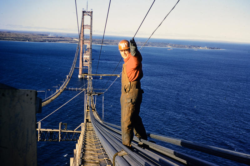 Former Argus employee Dick DeMara used an Argus C3 to document the construction of the Mackinac Bridge.  DeMara waves from the bridge.
