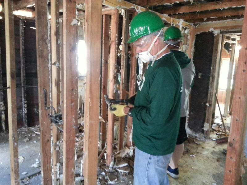 Head Coach Chris Creighton also helped with the Habitat for Humanity of Huron Valley house.