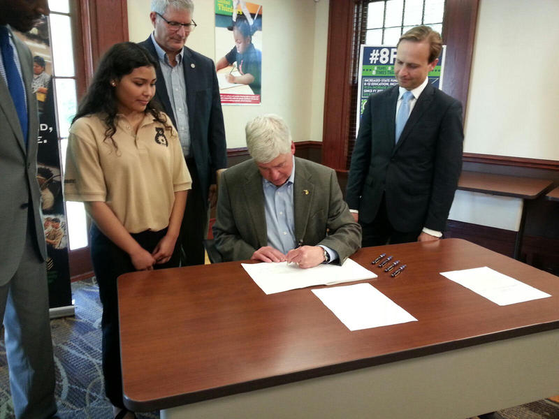 Governor Rick Snyder signs the 2019 education budget.