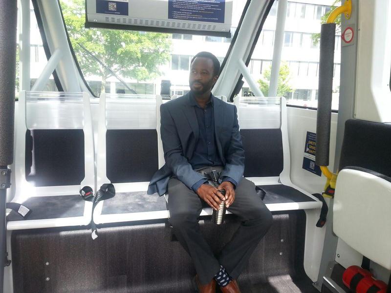 University of Michigan Attorney Ndu Ozor sits inside the shuttle.