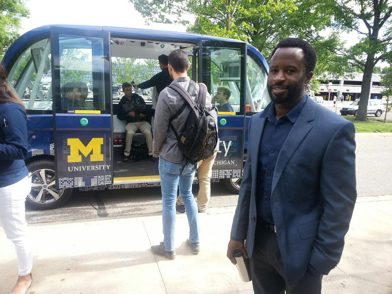 University of Michigan Attorney Ndu Ozor gets ready to board the shuttle.